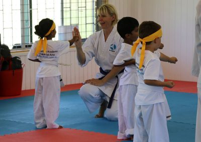 Sempai Heidi ensuring a firm punch for students in Little Leopards
