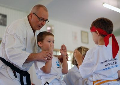 Tan Gan Ho: Sempai helping with arm kumae position