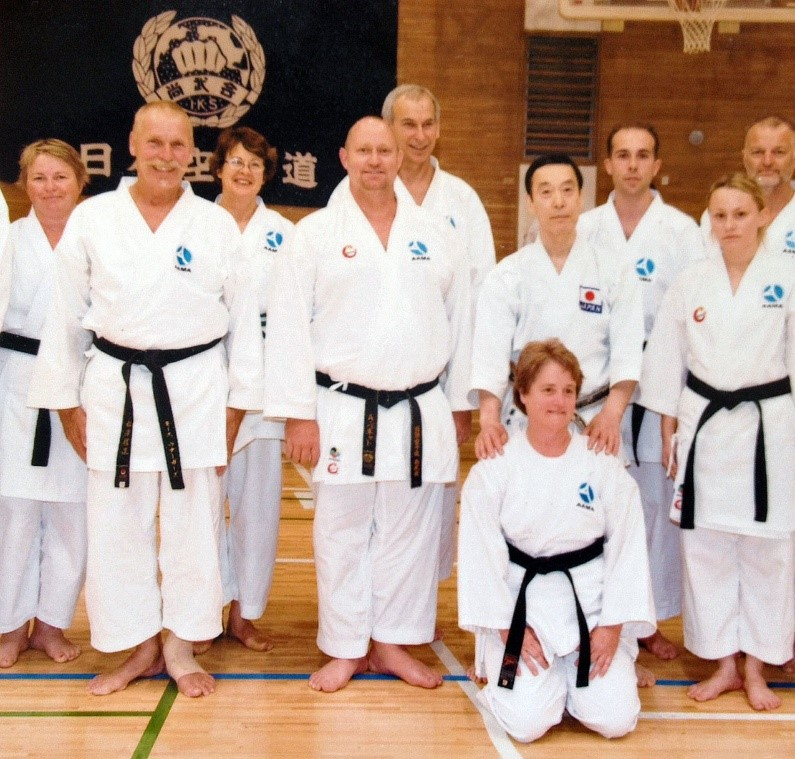 Sempai Cees far left with fellow members of AAMA in Japan with Sensei Fujimoto (second from right)